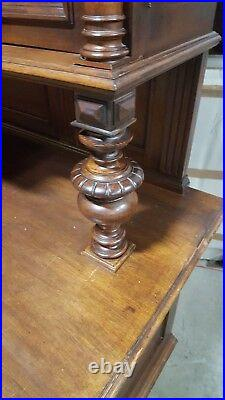 Antique German Carved Buffet Cabinet With Lion Faces
