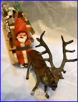 Antique Vintage Composition Santa in Sled W Toys Lead Metal Bugling Deer German