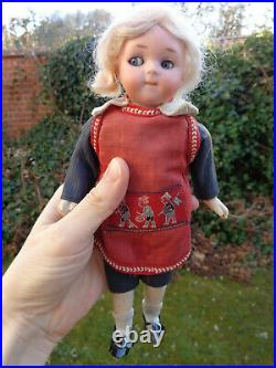 Antique doll rare googly doll with closed mouth original dress