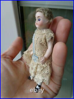Antique dollhouse doll mignonette closed mouth & flower hat dated about 1900