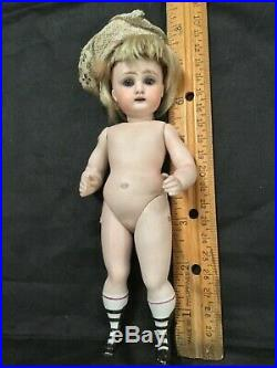 Antique peg-jointed all-bisque doll 4-strap bootines