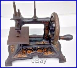 Antique vintage cast iron German  miniature child's sewing machine