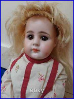 Beautiful antique doll with lovely dolldress