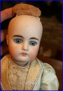 Very Early Unmarked German Doll straight arms & legs. Wonderful rayed eyes CM