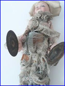 Vintage antique mechanical squeeze bisque doll jester with cymbals, Germany